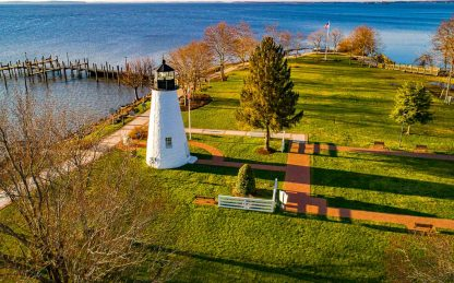 Aerial shot of Concord Point Lighthouse from a distance, at Dawn