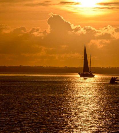 Sailboat in the Golden Sunrise